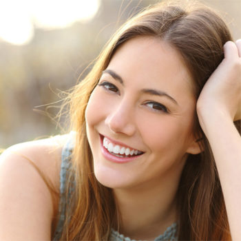 Smiling woman with her hand on her hair