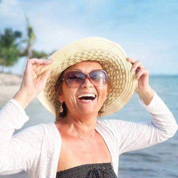 Woman smiling on a beach