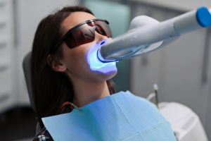 young female patient undergoing professional teeth whitening